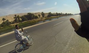 Cyclcing along a canal near Nile river in Egypt.