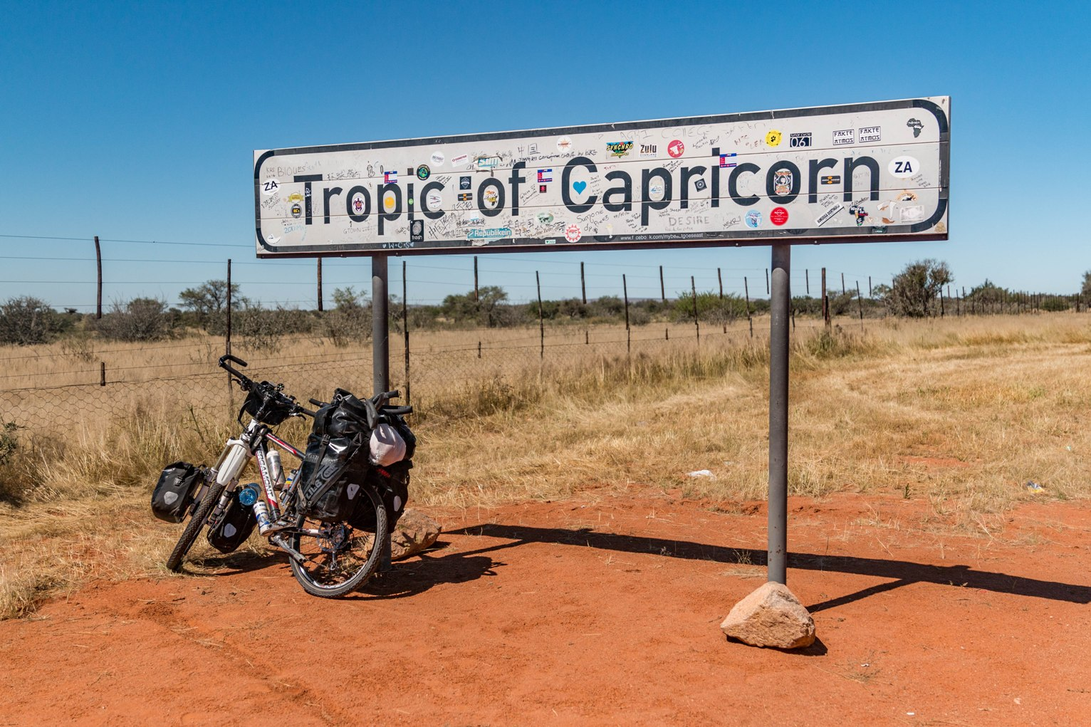 Cycle with my bicycle in Namibia near tropic of capricorn towards cape town