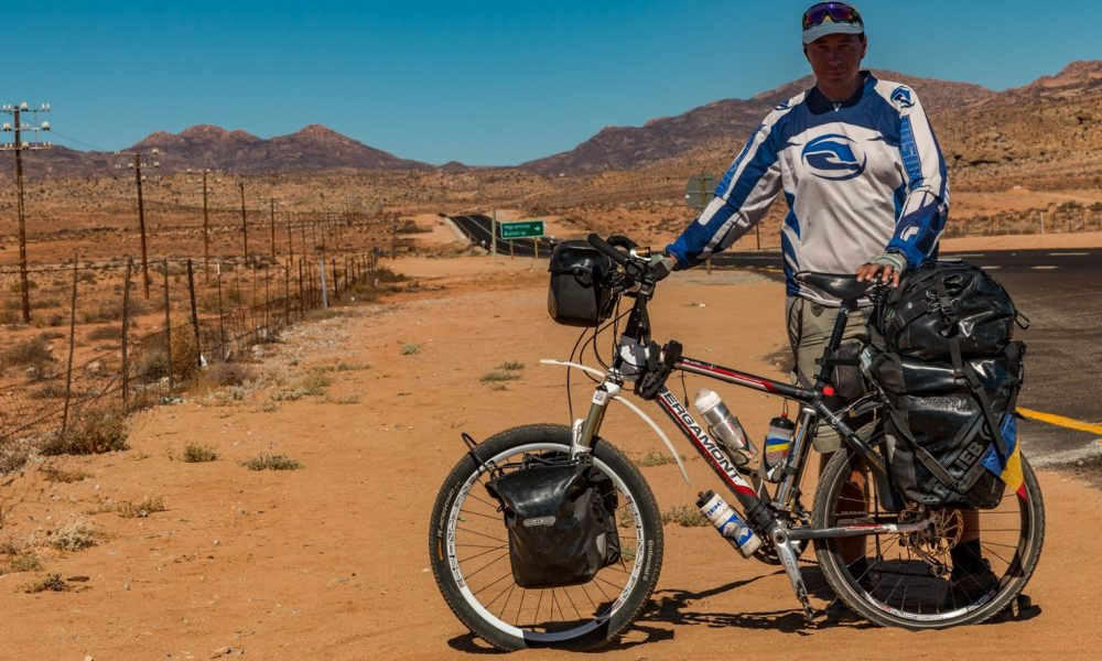 Cycle in South Africa on a bicycle on N7 road to Cape Town from Cairo.