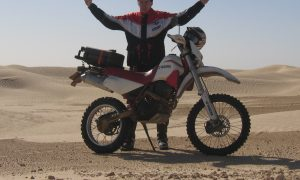 Motorcycle in Sahara in Tunisia, near Douz to Ksar Ghilane.